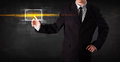 Tech business person touching button with orange light beams con Royalty Free Stock Photo