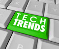 Tech trends words computer keyboard button top popular software on a green to illustrate best or most modern programs Royalty Free Stock Photos