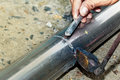 Techician is welding aluminium pipe by using soldering copper. Royalty Free Stock Photo