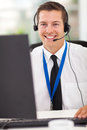 Technical call center happy operator with headphones Royalty Free Stock Photo