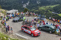 Technical cars in pyrenees mountains col de pailheres france july row of of various procycling teams climbing the road to col de Stock Photos
