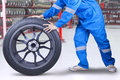 Technician changing a tire at workshop Royalty Free Stock Photo