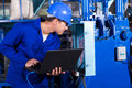 Technician distribution box industrial checking with laptop in factory Stock Images