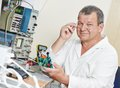 Technician engineer at work with microchip male technicial scientist plate test laboratory factory Stock Photos