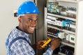 Technician Examining Fusebox With Multimeter Probe Royalty Free Stock Photo