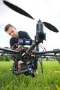 Technician fixing camera on spy drone young at park Stock Photography