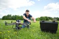 Technician fixing propeller of uav helicopter young with handtool in park Royalty Free Stock Photography