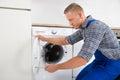 Technician Fixing Washing Machine Royalty Free Stock Photo