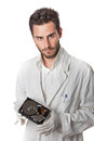 Technician holding hard disk a wearing lab coat an drive Stock Photography