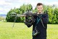 Technician holding uav octocopter in park portrait of confident male Stock Image