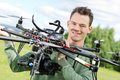 Technician holding uav octocopter portrait of confident male in park Stock Photo