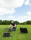 Technician preparing multirotor helicopter young in park Royalty Free Stock Images