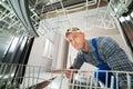 Technician Repairing Dishwasher Royalty Free Stock Photo
