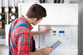 Technician servicing heating boiler the gas for hot water and Royalty Free Stock Photos