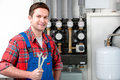 Technician servicing heating boiler the gas for hot water and Royalty Free Stock Images