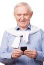 Technological wonders of nowadays happy senior man holding mobile phone while standing against white background Royalty Free Stock Photos