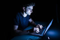 Technology internet communication and people concept young man  with laptop computer in the night time Royalty Free Stock Photo