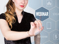 Technology, internet and networking concept. beautiful woman in a black business shirt. woman presses webinar button on Royalty Free Stock Photo