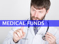 Technology internet and networking in medicine concept medical doctor presses medical funds button on virtual screens Stock Image