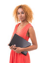 Technology news young woman in a red dress holding a laptop Stock Photography