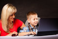 Technology and parenting boy and mother with laptop education internet concept computer Stock Photography