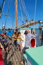 Passengers raising the sails on the New Zealand Maritime Museum`s heritage boat `Ted Ashby`, Auckland Harbour Royalty Free Stock Photo