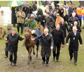 Ted veale st cheltenham seen here pooring rain winners enclosure Royalty Free Stock Images