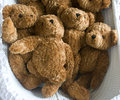 Teddies pile of discarded teddy bears in a basket Stock Photos