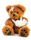 Teddy with bandage bear on white background Stock Photo