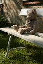 Teddy bear on bench Royalty Free Stock Image