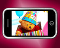 Teddy bear birthday gift photo op smartphone Stock Foto