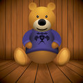 Teddy bear brown stuffed toy print on chest wooden background Stock Photography