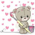 Teddy Bear with brush is drawing a hearts