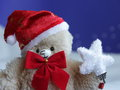 Teddy bear christmas card stock photo happy with white star on blue sky and snow background Stock Images