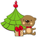 Teddy bear and christmas tree Royalty Free Stock Image