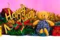 Teddy bear and christmas tree with presents on background Stock Images