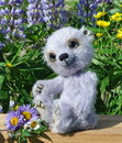 Teddy-bear Chupa among flowers Stock Photo