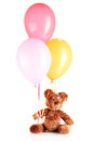 Teddy bear with colorful balloons Royalty Free Stock Photos