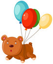The Teddy bear flies with balloon Royalty Free Stock Image