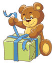 Teddy bear and gift box unpacks a with gifts Stock Photos