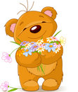 Teddy bear giving a bouquet Stock Images