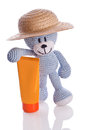 Teddy bear with hat and suncream lotion blue Stock Photo