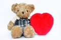 Teddy bear and heart Royalty Free Stock Photos