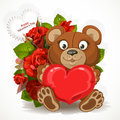 Teddy bear holding heart with a bouquet of flowers and valentine Stock Image