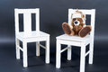 Teddy bear on little chair cute soft with white rose seated an child Royalty Free Stock Photos
