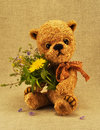 Teddy-bear Misha with flowers Stock Image