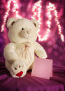 Teddy bear with a note paper white bokeh lights and Royalty Free Stock Photography