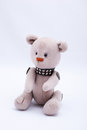 Teddy bear old toy made by hand sitting on a white background Royalty Free Stock Photo