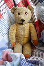 Teddy Bear on a Patchwork Quilt. Royalty Free Stock Photo
