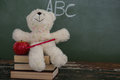 Teddy bear, pencil and apple on stack of books Royalty Free Stock Photo
